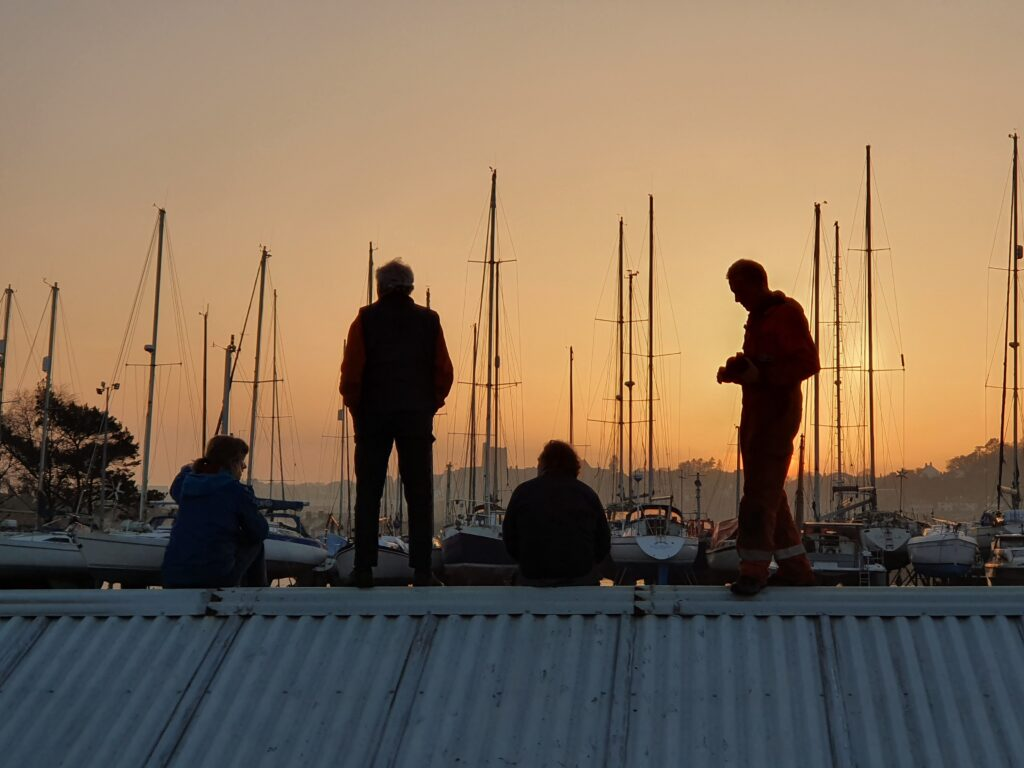 People on a roof enjoying the sunset