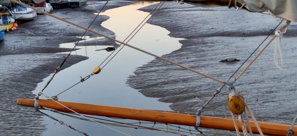 Low tide mudflats with bowsprit