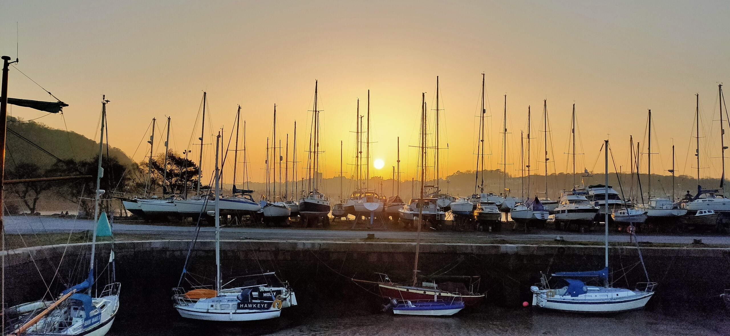 Sunset over the quayside with yachts