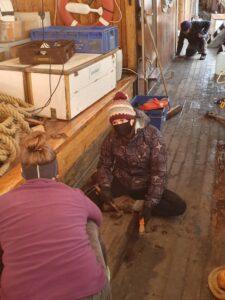 Volunteers working on the deck