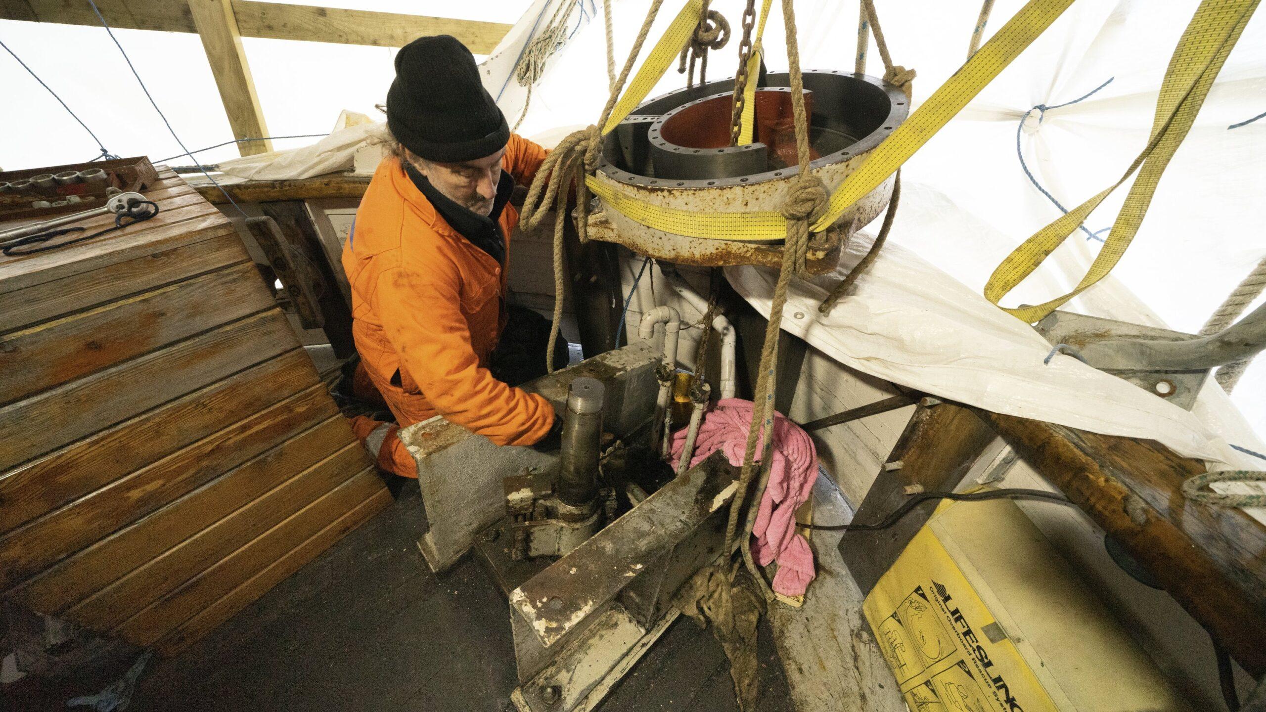 Man lifting large metal component