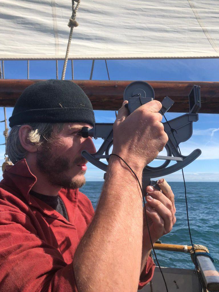 Crewman using sextant