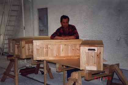 New wooden benches in workshop with carpenter