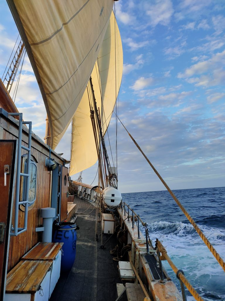 View along starboard side of sailing ship at sea